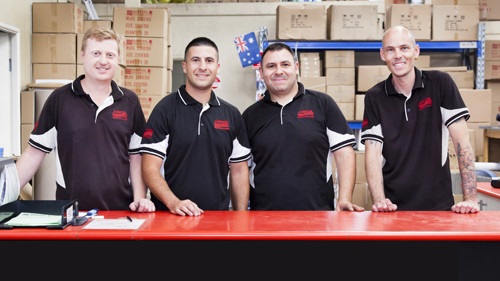 four airfoil staff at a counter